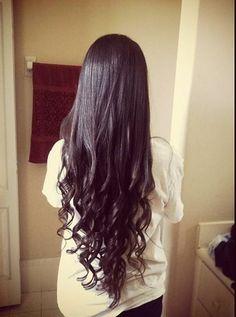 Long hair, dark curls.