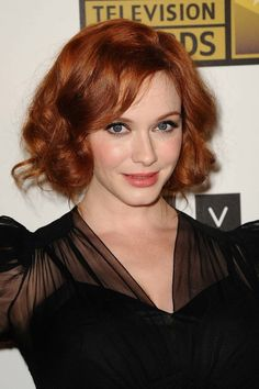 "Christina Hendricks has a red hair color everyone loves. It's fiery and vibrant yet is still a deep red—it's perfect for fall.  Look for terms like ""cinnamon"" and ""copper"" on at-home box kits."