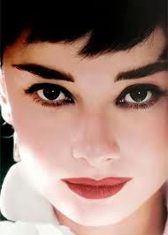 Audrey Hepburn  - wow, a great picture - eyebrows, eye liner and shadow and lipstick. You can get the look just by copying this picture.