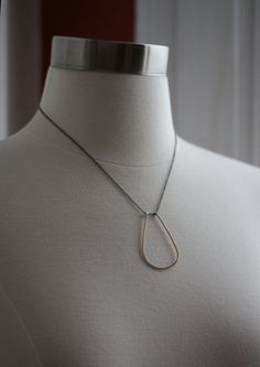 today I begin a list for things I want from Kemp...eventually :)  or ideas for him  simple horseshoe metal necklace by LexLuxe on Etsy, $85.00