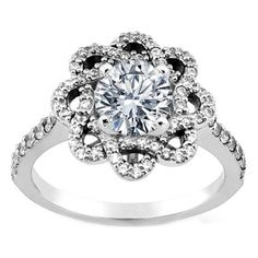 $1,240. Round Diamond Floral Halo Engagement Ring