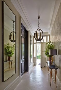 South Shore Decorating Blog...  Great Way to add Interest to a Long Hall without crowding it with Furniture and Accessories...Reflect it!