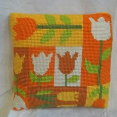 Marsha Brady Home Ec Project Needlepoint Pillow - I love that description by the seller.  Who else remembers Mrs. Brady doing needlepoint?