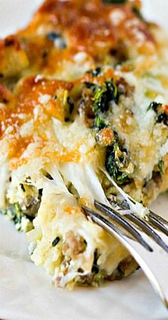 Cheesy Sausage Spinach Breakfast Casserole A wonderfully hearty breakfast casserole, perfect for a holiday morning or overnight houseguests. Paleo Breakfast, Breakfast Dishes, Breakfast Time, Best Breakfast, Breakfast Recipes, Breakfast Cassarole, Breakfast Casserole Sausage, Breakfast Burritos, Christmas Breakfast Casserole
