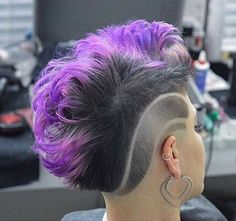 Colored hair. Fierce haircut. Added by ChunkyDiva