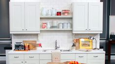 10 Ways to Jazz Up Your Kitchen | Steven and Chris | The all white kitchen is probably the most popular look right now, and Suzanne Dimma's got 10 great ways to inject a little life into that blank slate without renovating. Above: kitchen cabinets, sink, hardware, faucet, table light, Ikea; vintage...