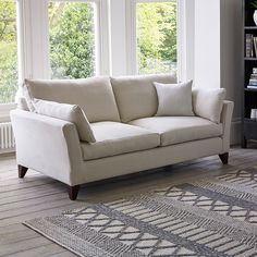 Defined by refined style, our Alana range of living room furniture features gently sloping arms and contrasting tapered legs. Available in a variety of loose cover finishes and the choice of light or dark feet.