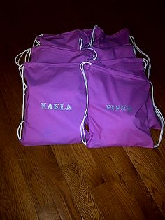 Loot bags for my daughter's 8th birthday party. It's a spa party - each bag has the little girl's name on it and contains a white waffle weave robe.  All purchased via cottonage.com. Total loot bag cost: less than $15 each