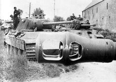 A Panther unit as viewed over a main gun's muzzle brake. The Panthers belongs to the elite Panzer Lehr Division. Following D-Day in June 1944 it fought British & Canadian forces near Caen delaying Allied seizure of vital towns & objectives by weeks, and in July, Lehr was moved to battle the Americans around Saint-Lô. The photo was taken immediately after the invasion of France...