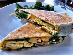 Replicate this breakfast wrap at Umphs/Arnold. Wrap scrambled eggs, spinach, ham, and salsa in a flour tortilla and grill press.  Photo via Katherine Lim on Flickr