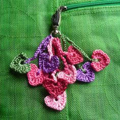 I like this on the idea of a cluster of small hearts on a zipper pull.....Crochet hearts keyring