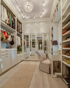 heavenly walk-in closet with a vanity and shoe and purse storage - what dreams look like...
