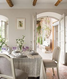Dining Room with French Doors to Porch #dining #room #arched #door #windows #french #home #gray #white