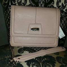 NWT BCBG cross body bag in Peach/Blush NWT purchased from distribution center No flaws Original tags attached. Color labeled Peach, but is more of a Blush. Gold chain link strap, can be cross body or shoulder style. Duster included Also selling in taupe and black  Smoke and pet free home, reasonable offers considered  Don't forget to bundle for discounts! BCBG Bags Crossbody Bags