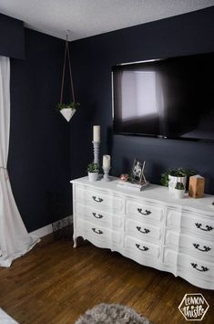 This navy master bedroom is so great with the vintage white dresser! I like how &; This navy master bedroom is so great with the vintage white dresser! I like how &; Navy Master Bedroom, Master Bedroom Makeover, Blue Bedroom, Pretty Bedroom, Bedroom With Tv, Girls Bedroom, Bedroom Simple, Vintage White Dresser, Bedroom Vintage