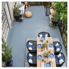 Create an outdoor courtyard area that's classic, comfortable and family friendly with this Modern Outdoor Patio Collection styled by Emily Henderson. Blue, white and black hues with copper and natural wood accents tie together this backyard retreat. Patio Dining Chairs, Outdoor Dining, Outdoor Spaces, Outdoor Decor, Outdoor Lighting, Lighting Ideas, Dining Rooms, Outdoor Furniture, Outdoor Ideas