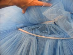 The hoop is inserted into the casting. The size of the hoop helps determine the shape ofthe tutu -- smaller for more bell-shaped or larger for more flat.