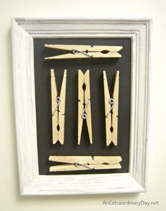 I love this simple and easy idea from AnExtraordinaryDay.net for creating art with clothespins for laundry room decor.  True decorating on a dime.