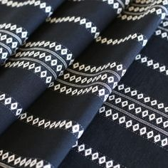 A woven, black + white striped fabric with a global feeling. Suitable for upholstery, drapery, curtains, roman blinds, cushions, pillows and other home decor ac