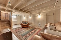Rustic Basement With Restoration Hardware Lancaster Leather Swivel Chair,  Exposed Beam, Whitewashed Exposed Beam Ceiling