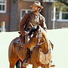Hugh Jackman looking very Australian in this pic! I think I have a thing for scruffy men on horses.