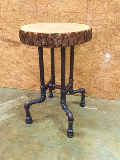 """Cherry slab seat on 3/4"""" black iron pipe; this 24"""" stool doubles as a plant stand or side table."""