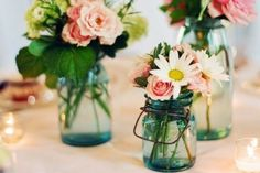 We have lots of mason jars and here are some ideas we are thinking about using them for! Image courtesy of newlyweds-blog.com.