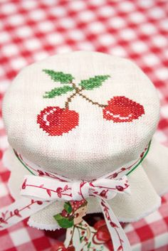 Cross stitch cherry jar covers--these would be cute with crocheted cherry potholders that I pinned a couple days ago...have to go find those!