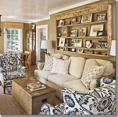 love the shelves behind the sofa, though maybe in a lighter colour. Refurbished Wood Beams.