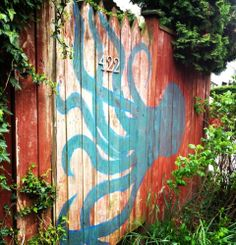 Artistic fence idea with octopus painting.