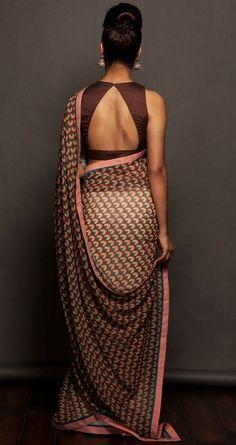 Sober chocolate saree blouse back                                                                                                                                                                                 More