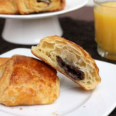"""Step-by-step chocolate croissants recipe - """"Golden brown and slightly crisp on the outside, which yielded to the most delicious buttery, flaky interior. And of course, there was the chocolate! It melted perfectly in the oven (thankfully without escaping the croissants) and really took these croissants to the next level."""""""