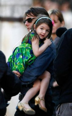 """Tom Cruise holds his daughter Suri during a break in the filming of """"Knight & Day""""in Spain."""