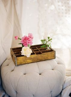 Elegant flowers in a rustic crate.
