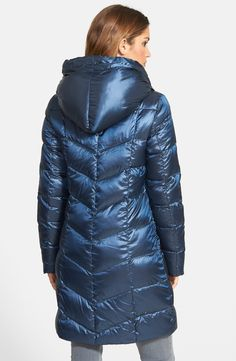 Free shipping and returns on T Tahari 'Gisele' Packable Hooded Down Coat at Nordstrom.com. A cozy pillow collar falls into a generous hood atop a luminous chevron-quilted coat insulated with crushably soft down fill that easily compresses for packing. Wide grosgrain drawcords and a cutaway front hem polish the design.
