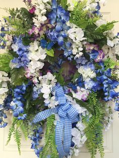 Premium Blue and Purple Wisteria Summer Mesh Wreath by WilliamsFloral on Etsy https://www.etsy.com/listing/385100158/premium-blue-and-purple-wisteria-summer