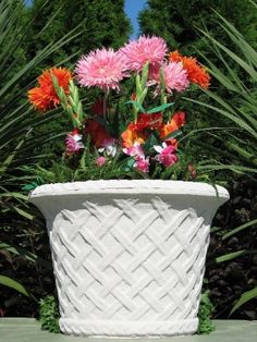 The Brighton Jardiniere concrete garden container is cast from a mold at Nichols Bros. with quality concrete mix aggregates using the dry tap casting which produces a texture that simulates the nutural look and feel of cut limestone.
