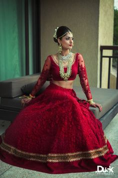 deep jewel toned rich red all over threadwork bridal lehenga in one color, monotone, georgette, thread and pearl wotj, full sleeves blouse with sheer sleeve and beading, long rrani haar , red lipstick , deep red, raspberry red , blood red