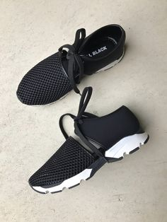 All Black Footwear - Break away from traditional sneakers with this fashion-forward style - Two-piece fabric and mesh upper - Lace-up closure - Lightly cushioned footbed