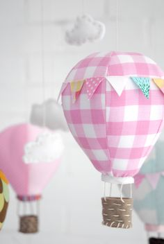 Handmade hot air balloon mobile for baby. I love the hot air balloon theme for a nursery!