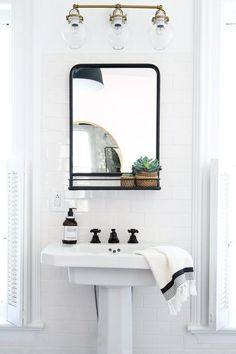 Bathrooms pedestal sink, iron mirror with shelf, light walls Save Money While You Survive the Heat S Serene Bathroom, Beautiful Bathrooms, Modern Bathroom, Bathroom Ideas, White Bathrooms, Bathroom Designs, Bathroom Small, Bathroom Inspo, Dream Bathrooms