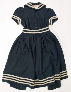Bathing suit- 1885.  American. Medium: Wool, cotton, straw. Sailor like look very popular at this time.