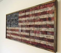 Recommissioned Flag #3  Oil on pine  43.5 x 21 x 2 inches  Matthew Jarmer    This is an original American flag wall hanging made of reclaimed pine 2x4s. Each piece is cut and hand painted with multiple layers to bring out the grain in the wood as well as create depth in each block. I purposefully cut through the knots in the wood to add interest to some of the blocks, each one is unique. Different boards were used for the red, white and blue fields and the grains were lined up to help give…