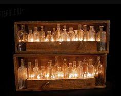 Lighting: rope lights? behind old medicine bottles in wooden shelving. (Urbanrevivaldesign.com)