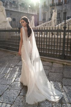 f9cc160dbadc Very special wedding gown with original cape and beautiful details. Ostin  by Dominiss.