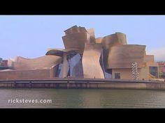 """Il Guggenheim Museum di Bilbao in Spagna, opera """"decostruttivista"""" dell'architetto Frank Ghery (n.1929).  Il progetto ha portato Gehry alla popolarità internazionale grazie alle sue forme nuove e allo splendore dato dal rivestimento in titanio. La progettazione e la realizzazione di una struttura così complessa è stata resa possibile grazie all'utilizzo dei più moderni software di progettazione e di calcolo. L'edificio é considerato uno dei capolavori mondiali dell'architettura…"""
