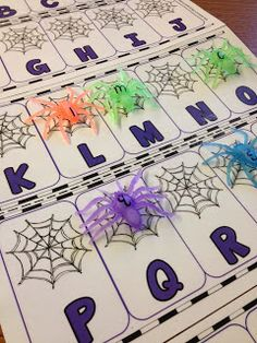 Use small rubber spiders with letters for this free printable letter recognition activity.