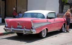 Pink Bel Air ... reminds me of my dads car... wish he still had it!