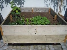 Garden Furniture Made From Scaffolding Planks raised bed with built-in seat from recycled scaffolding boards