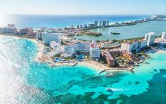 4. Cancun Beach. The vacation destination of Cancun is well-known for its gorgeous beaches and turquoise waters. This strip along the coast of the Gulf of Mexico is full of many different resorts, restaurants and shops that are great places to stay and play. The region is reminiscent of the Vegas strip, with all of the resorts being close together in a line, with miles of sand around them. Touropia